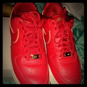 Universal red and gold air force 1's